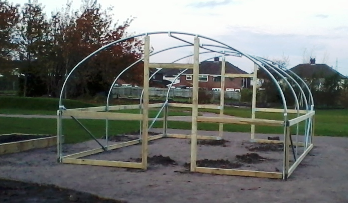 Polytunnel with timber rails